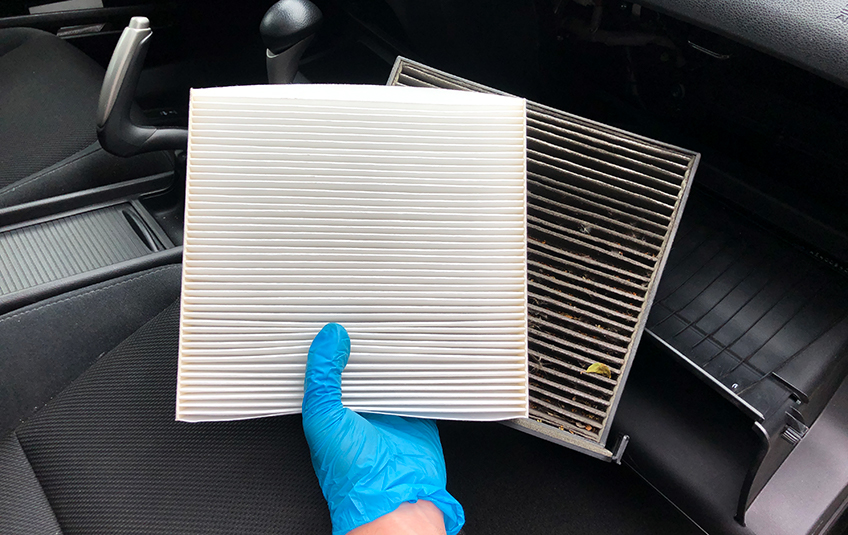 Comparing a clean cabin filter to a dirty cabin air filter