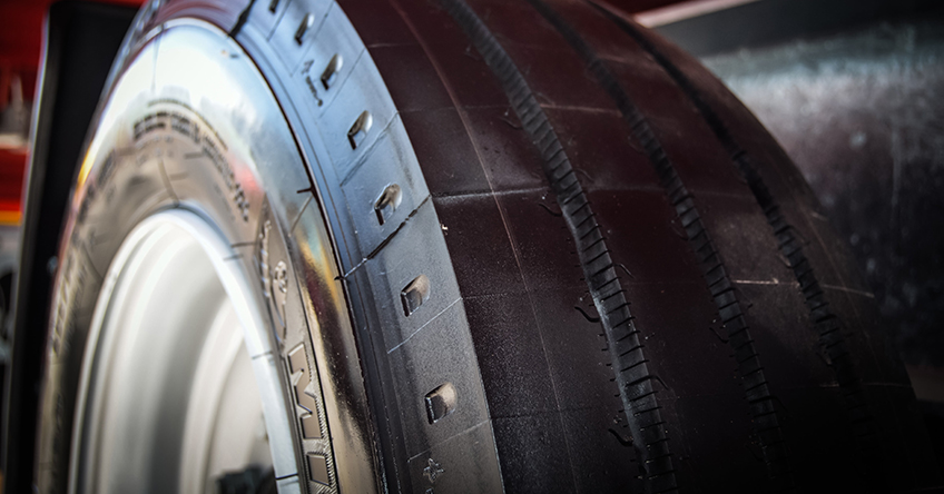 A close-up of a trailer's shiny new tire
