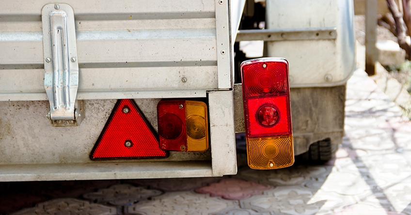 A close-up of some of a trailer's taillights that need to be checked when doing trailer maintenance