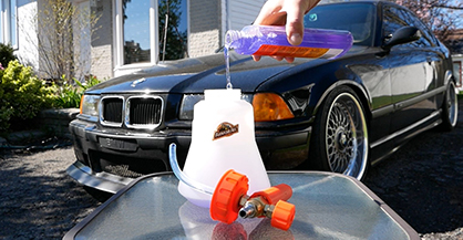 Car wash soap being poured into car wash cannon